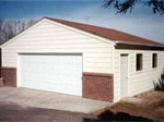 Two Car Garage with Brick and Vynal